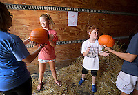 NWA Democrat-Gazette/BEN GOFF @NWABENGOFF<br /> Lucile Latham, 13, and Liam Conley, 11, help unload a truckload of pumpkins on Sunday Sept. 27, 2015 at First United Methodist Church Downtown Bentonville. Members of the the church's youth group, Kryptonite youth softball team and Downtown Kids were setting up the church's annual pumpkin patch, which will be open each day of the week from 2-6:00p.m. starting Monday. Proceeds from pumpkin sales will help support a youth mission trip to Haiti in March.