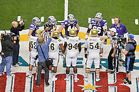 Members of UCLA Bruins and Kansas State watch Referee Jerry McGinn perform ceremonial coin toss before Alamo Bowl kickoff, Friday, January 02, 2015 in San Antonio, Tex. (Mo Khursheed/TFV Media via AP Images)