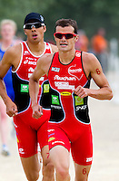13 JUN 2010 - BEAUVAIS, FRA - Frederic Belaubre (right) leads Beauvais team mate Aurelien Raphael during the Beauvais leg of the French Grand Prix triathlon series (PHOTO (C) NIGEL FARROW)
