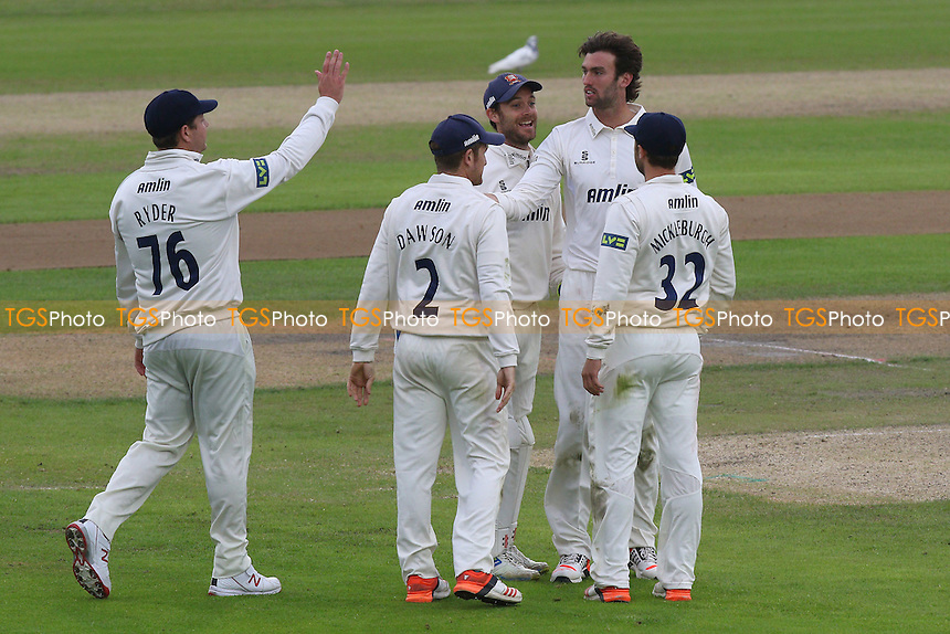 Reece Topley of Essex (2nd R) celebrates taking the wicket of Jordan Clark - Lancashire CCC vs Essex CCC - LV County Championship Division Two Cricket at Emirates Old Trafford, Manchester - 08/07/15 - MANDATORY CREDIT: Gavin Ellis/TGSPHOTO