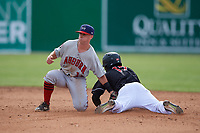 Auburn Doubledays second baseman Phil Caulfield (1) attempts to tag Dalvy Rosario (17) sliding in during a NY-Penn League game against the Batavia Muckdogs on June 19, 2019 at Dwyer Stadium in Batavia, New York.  Batavia defeated Auburn 5-4 in eleven innings in the completion of a game originally started on June 15th that was postponed due to inclement weather.  (Mike Janes/Four Seam Images)