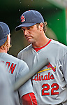 2 September 2012: St. Louis Cardinals Manager Mike Matheny discusses strategy in the dugout during a game against the Washington Nationals at Nationals Park in Washington, DC. The Nationals edged out the visiting Cardinals 4-3, capping their 4-game series with three wins. Mandatory Credit: Ed Wolfstein Photo