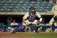 Western Carolina Catamounts catcher Kitt Capell (12) fields a throw at home plate during the game against the Saint Joseph's Hawks at TicketReturn.com Field at Pelicans Ballpark on February 23, 2020 in Myrtle Beach, South Carolina. The Hawks defeated the Catamounts 9-2. (Brian Westerholt/Four Seam Images)