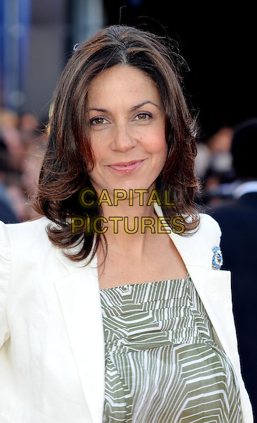 Julia Bradbury.UK Premiere of 'Cowboys and Aliens' at the Cineworld cinema at the O2 Arena, London, England..August 11th 2011.half length white blazer jacket beige green print pattern top stripe.CAP/WIZ.© Wizard/Capital Pictures.