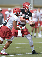 NWA Democrat-Gazette/ANDY SHUPE<br /> Arkansas quarterback Cole Kelly hands the ball off to running back Devwah Whaley Tuesday, Aug. 7, 2018, during practice at the university practice fields in Fayetteville. Visit nwadg.com/photos to see more photographs from the practice.