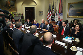 United States President Barack Obama (3R) and Vice President Joe Biden meet with executives from leading technology companies, including Apple, Twitter, and Google in the Roosevelt Room of the White House on December 17, 2913 in Washington, DC. The White House said the meeting focused on efforts to repair administration's troubled HealthCare.gov website.<br /> Credit: Mark Wilson / Pool via CNP