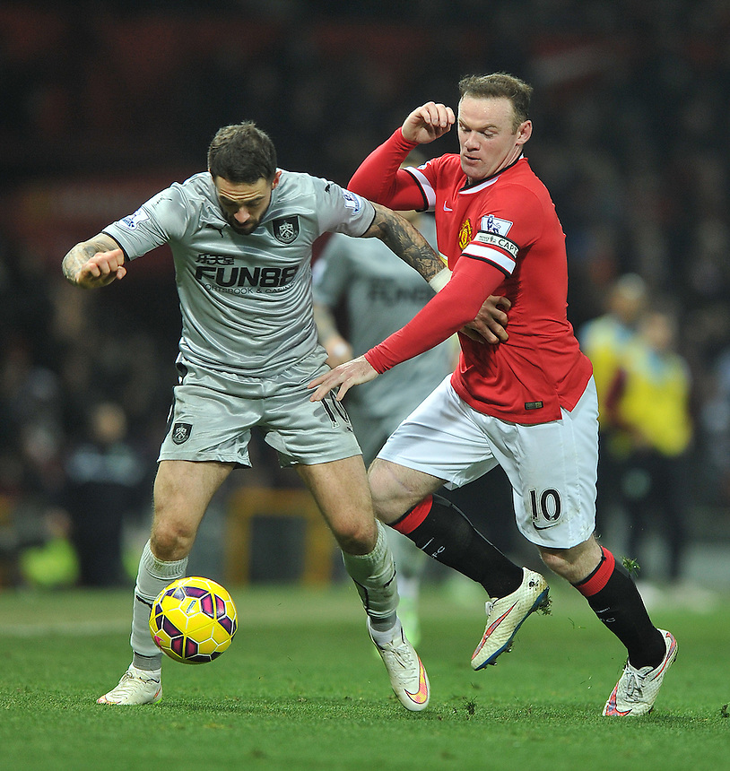 Burnley's Danny Ings and Manchester United's Wayne Rooney battle for the ball<br /> <br /> Photographer Dave Howarth/CameraSport<br /> <br /> Football - Barclays Premiership - Manchester United v Burnley - Wednesday 11th February 2015 - Old Trafford - Manchester<br /> <br /> &copy; CameraSport - 43 Linden Ave. Countesthorpe. Leicester. England. LE8 5PG - Tel: +44 (0) 116 277 4147 - admin@camerasport.com - www.camerasport.com