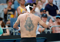 26th January 2020; Melbourne Park, Melbourne, Victoria, Australia; Australian Open Tennis, Day 7; Fabio Fognini of Italy displays his back tattoo during his match against Tennys Sandgren of USA
