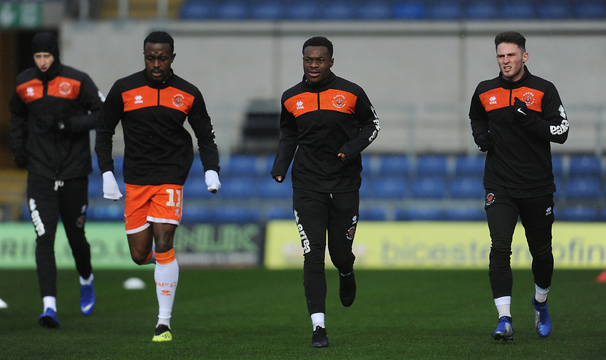 Blackpool's Joe Bunney, Joe Dodoo, Marc Bola and Jordan Thompson during the pre-match warm-up <br /> <br /> Photographer Kevin Barnes/CameraSport<br /> <br /> The EFL Sky Bet League One - Oxford United v Blackpool - Saturday 15th December 2018 - Kassam Stadium - Oxford<br /> <br /> World Copyright © 2018 CameraSport. All rights reserved. 43 Linden Ave. Countesthorpe. Leicester. England. LE8 5PG - Tel: +44 (0) 116 277 4147 - admin@camerasport.com - www.camerasport.com