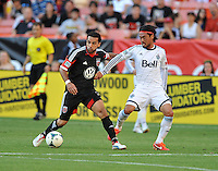Dwayne De Rosario (7) of D.C. United goes against Daigo Kobayashi (14) of the Vancouver Whitecaps FC. The Vancouver Whitecaps FC defeated D.C. United 1-0, at RFK Stadium, Saturday June 29 , 2013.