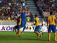 Thursday 29 August 2013<br /> Pictured: Mircea Bornescu goalkeeper for Petrolul Ploiesti makes a save from a Swansea cross.<br /> Re: Petrolul Ploiesti v Swansea City FC UEFA Europa League, play off round, 2nd leg, Ploiesti, Romania.