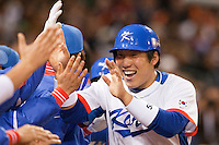 17 March 2009: #50 Hyun Soo Kim of Korea celebrates with teammates as he scores during the 2009 World Baseball Classic Pool 1 game 4 at Petco Park in San Diego, California, USA. Korea wins 4-1 over Japan.