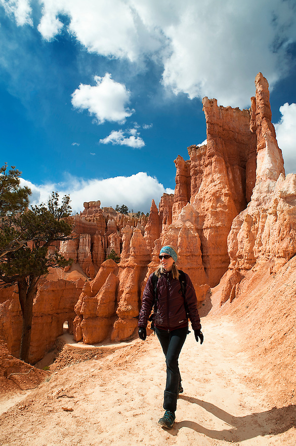 A hiker explores the Queen's Garden Trail in Bryce Canyon National Park.