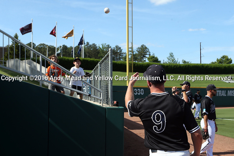 28 May 2016: Nova Southeastern's Steven Fleming (9) plays catch with a couple of kids. The Nova Southeastern University Sharks played the Franklin Pierce University Ravens in Game 3 of the 2016 NCAA Division II College World Series  at Coleman Field at the USA Baseball National Training Complex in Cary, North Carolina. Nova Southeastern won the game 4-3 in twelve innings.