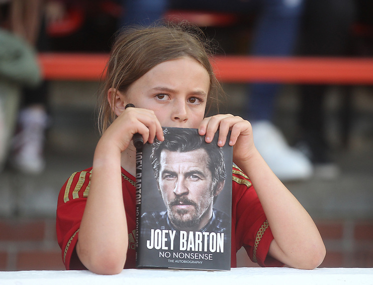 An young fan with a Joey Barton book<br /> <br /> Photographer Mick Walker/CameraSport<br /> <br /> The Carabao Cup First Round - Nottingham Forest v Fleetwood Town - Tuesday 13th August 2019 - The City Ground - Nottingham<br />  <br /> World Copyright © 2019 CameraSport. All rights reserved. 43 Linden Ave. Countesthorpe. Leicester. England. LE8 5PG - Tel: +44 (0) 116 277 4147 - admin@camerasport.com - www.camerasport.com