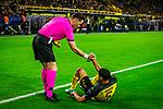 05.11.2019, Signal Iduna Park, Dortmund , GER, Champions League, Gruppenphase, Borussia Dortmund vs Inter Mailand, UEFA REGULATIONS PROHIBIT ANY USE OF PHOTOGRAPHS AS IMAGE SEQUENCES AND/OR QUASI-VIDEO<br /> <br /> im Bild | picture shows:<br /> Referee | Schiedsrichter Danny Makkiele (NED) hilft dem gefoulten Achraf Hakimi (Borussia Dortmund #5) auf die Beine, <br /> <br /> Foto © nordphoto / Rauch
