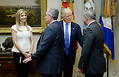 United States President Donald Trump and daughter Ivanka Trump greet participants before a listening session on domestic and international human trafficking in the Roosevelt Room of the White House on February 23, 2017 in Washington, DC. <br /> Credit: Olivier Douliery / Pool via CNP