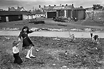 Limerick, in County Limerick, Southern Ireland Eire 1979. Sisters playing together.