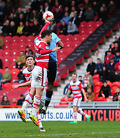Doncaster Rovers' Mathieu Baudry handles the ball, under pressure from Blackpool's Jamille Matt, giving away a penalty<br /> <br /> Photographer Chris Vaughan/CameraSport<br /> <br /> The EFL Sky Bet League Two - Doncaster Rovers v Blackpool - Keepmoat Stadium - Doncaster<br /> <br /> World Copyright &copy; 2017 CameraSport. All rights reserved. 43 Linden Ave. Countesthorpe. Leicester. England. LE8 5PG - Tel: +44 (0) 116 277 4147 - admin@camerasport.com - www.camerasport.com