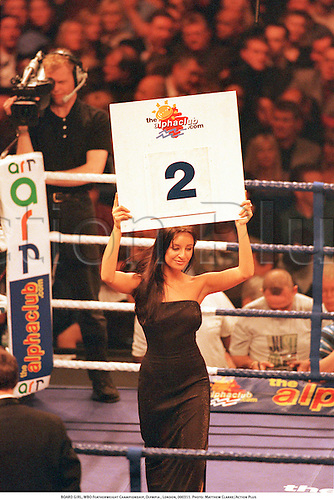 BOARD GIRL, WBO Featherweight Championship, Olympia , London, 000311. Photo: Matthew Clarke/Action Plus...2000.boxing.ring.ropes.numbers.