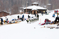 Jeff King runs down the road as he leaves the village checkpoint of Ruby during the 2010 Iditarod
