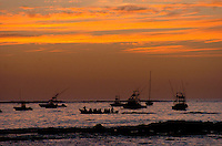 Sunset on the fishing boats in Tamarindo, Costa Rica.