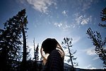 A woman wears a head net in the Sawtooth Mountains of Idaho.