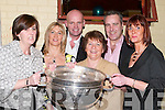 CUP: Getting a grip of the Sam Maguire Cup at the John Mitchels GAA Social at their Clubhouse in Tralee on Saturday night. Front l-r: Jill O'Donovan, Martha Kilgallen, Breda and Christine Hurley. Back l-r: John Joe Sheehy and Timmy O'Dowd..