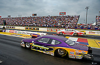 April 30, 2011; Baytown, TX, USA: NHRA pro stock driver Vincent Nobile (near) races alongside Mike Edwards during the Spring Nationals at Royal Purple Raceway. Mandatory Credit: Mark J. Rebilas-