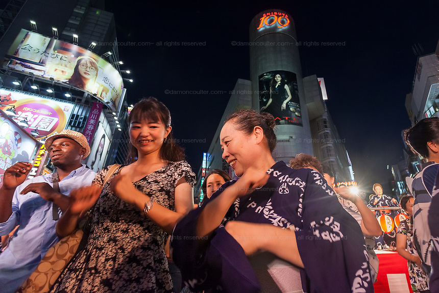Japanese people and tourists dance in the street during the first ever Bon Odori festival held in Shibuya.Tokyo, Japan. Saturday August 5th 2017 The streets around the iconic 109 building were closed to traffic for the festival of traditional summer dancing.
