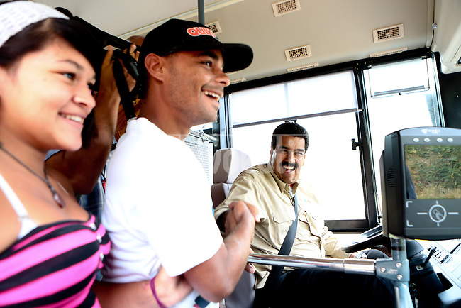 Venezuelan President and presidential candidate Nicolas Maduro drives a bus in Caracas. Maduro, a former bus driver for the Metro of Caracas will face opposition leader Henrique Capriles in a national election to choose the successor of Hugo Chavez