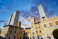 The Piazza Duomo (Cathedral Square) of San Gimignano with its medieval towers built as defensive towers and also to show the families wealth by the height of the tower. A UNESCO World Heritage Site. San Gimignano; Tuscany Italy