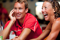 Chrissie Wellington relaxes with her partner Tom after winning the Challenge Roth Ironman Triathlon, Roth, Germany, 10 July 2011
