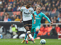25th January 2020; Mestalla, Valencia, Spain; La Liga Football,Valencia versus Barcelona; Geoffrey Kondogbia of Valencia CF is challenged by Antoine Griezmann of FCB