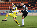 PARS JOE CARDLE CLEARS AS KILMARNOCK'S LEWIS TOSHNEY MAKES A CHALLENGE