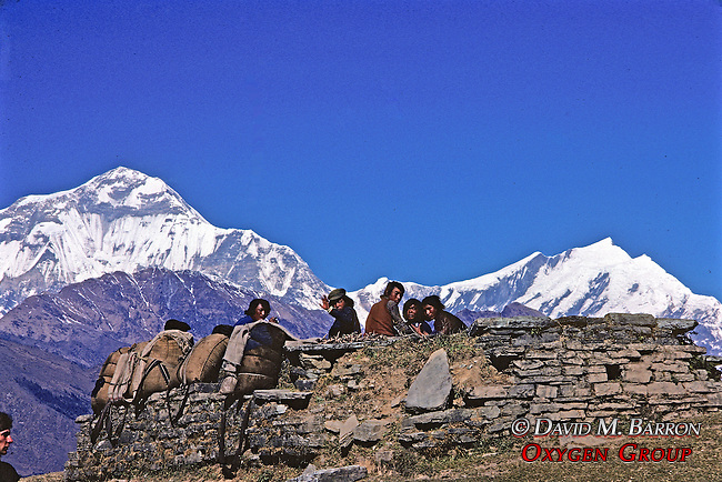 Men Resting With Annapurna In Background