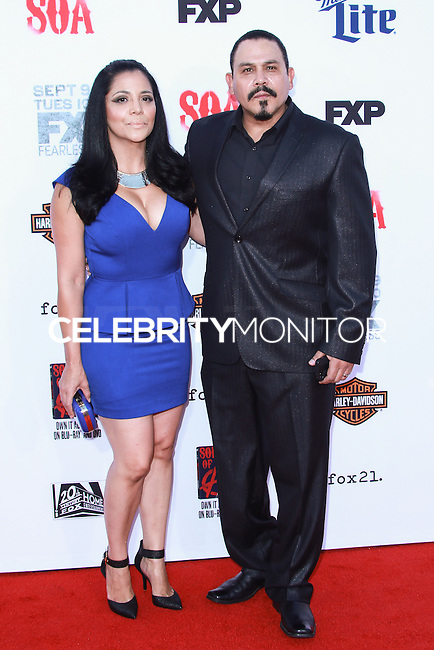 HOLLYWOOD, LOS ANGELES, CA, USA - SEPTEMBER 06: Yadi Valerio Rivera, Emilio Rivera arrive at the Los Angeles Premiere Of FX's 'Sons Of Anarchy' Season 7 held at the TCL Chinese Theatre on September 6, 2014 in Hollywood, Los Angeles, California, United States. (Photo by David Acosta/Celebrity Monitor)