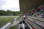 Fans in the stand watching Gala Fairydean Rovers in action during their first home match in the Scottish Lowland Football League against Edinburgh City at Netherdale in Galashiels. Gala were formed in 2013 by an a re-amalgamation of Gala Fairydean and Gala Rovers, the two clubs having separated in 1908 and their ground in the Scottish Borders had one of only two stands designated as listed football stands in Scotland. The match ended in a 3-3 draw watched by 378 spectators.