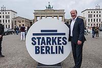 Praesentation der CDU-Kampagne fuer die Abgeordnetenhauswahl am 18. September 2016 in Berlin.<br /> Der CDU-Landesvorsitzende Frank Henkel stellte am Mittwoch den 6. April 2016 zusammen mit dem<br /> Wahlkampfleiter Kai Wegner und dem<br /> Kampagnenmanager Thomas Heilmann die Kampagne der Berliner CDU zur Abgeordnetenhauswahl vor. Konkrete Plakate mit Fotomotiven konnten nur eingeschraenkt gezeigt werden, da die CDU die Nutzungsrechte nicht erworben hat. So wurden den Journalisten nur Plakatideen und das Logo der Kampagne praesentiert.<br /> Im Bild: Kai Wegner posiert mit dem Wahlkampflogo vor dem Brandenburger Tor.<br /> 6.4.2016, Berlin<br /> Copyright: Christian-Ditsch.de<br /> [Inhaltsveraendernde Manipulation des Fotos nur nach ausdruecklicher Genehmigung des Fotografen. Vereinbarungen ueber Abtretung von Persoenlichkeitsrechten/Model Release der abgebildeten Person/Personen liegen nicht vor. NO MODEL RELEASE! Nur fuer Redaktionelle Zwecke. Don't publish without copyright Christian-Ditsch.de, Veroeffentlichung nur mit Fotografennennung, sowie gegen Honorar, MwSt. und Beleg. Konto: I N G - D i B a, IBAN DE58500105175400192269, BIC INGDDEFFXXX, Kontakt: post@christian-ditsch.de<br /> Bei der Bearbeitung der Dateiinformationen darf die Urheberkennzeichnung in den EXIF- und  IPTC-Daten nicht entfernt werden, diese sind in digitalen Medien nach §95c UrhG rechtlich geschuetzt. Der Urhebervermerk wird gemaess §13 UrhG verlangt.]