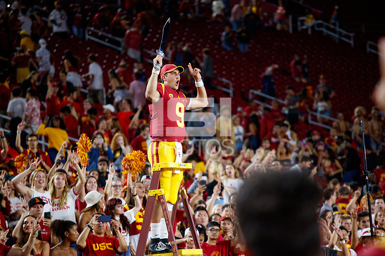 LOS ANGELES, CA - SEPTEMBER 8: USC Trojans quarterback Kedon Slovis #9 celebrates his first win from the marching band director's ladder during a game between USC and Stanford Football at Los Angeles Memorial Coliseum on September 7, 2019 in Los Angeles, California.
