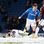 Callum Paterson slips on the snow and Kyle Hutton races off with the yellow ball
