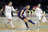 Caja Segovia's Fabian Robledo (l) and Borja Diaz (r) and FC Barcelona Alusport's Aicardo during Spanish National Futsal League match.November 24,2012. (ALTERPHOTOS/Acero) /NortePhoto