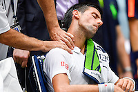 NEW YORK, USA - SEPT 09, Novak Djokovic of Serbia receives medical assistance while playing against Gael Monfils of France during their Men's Singles Semifinal Match of the 2016 US Open at the USTA Billie Jean King National Tennis Center on September 9, 2016 in New York.  photo by VIEWpress