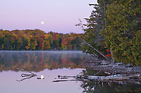 The Moon sets over the Hiawatha National Forest in Schoolcraft County at Pete's Lake in Michigan's Upper Peninsula