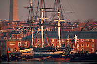 The USS Constitution (aka - Old Ironsides) with the Bunker Hill Monument in the background. Boston, Massachusetts.