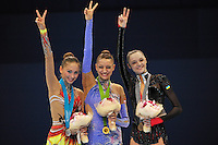 September 11, 2009; Mie, Japan;  (L-R) Daria Kondakova (silver), Evgeniya Kanaeva (gold) of Russia and Anna Bessonova (bronze) of Ukraine celebrate winning individual All Around medals at 2009 World Championships Mie. Photo by Tom Theobald .