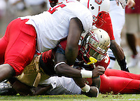 TALLAHASSEE, FL 10/31/09-FSU-NCST FB09 CH59-Florida State's Jermaine Thomas lunges for an extra yard as N.C. State's Brian Slay sends him to the turf during first half action Saturday at Doak Campbell Stadium in Tallahassee. .COLIN HACKLEY PHOTO