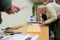 "Stephen Hall adds his signature to the ballot petition for Shenna Bellows, Democratic candidate in Maine for US Senate, at the Kittery Democrats town caucus in the Town Hall Council Chambers in Kittery, Maine, USA, on March 3, 2014. After listening to Bellows speak, Hall said he was ""very impressed"" by the candidate and considers himself a supporter. Candidates must collect a certain number of valid citizen signatures to be included on the ballot. Bellows is trying to unseat incumbent Maine Republican Senator Susan Collins in the 2014 election. The town caucus had speeches from various other local candidates and also served to choose delegates for the 2014 Maine State Democratic Caucus."
