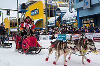 Mitch Seavey and team leave the ceremonial start line with an Iditarider and handler at 4th Avenue and D street in downtown Anchorage, Alaska on Saturday March 3rd during the 2018 Iditarod race. Photo ©2018 by Brendan Smith/SchultzPhoto.com