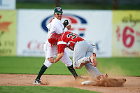 Jamestown Jammers second baseman Yefri Perez #18 attempts to turn a double play as Kolby Byrd #37 collides into him as Byrd's cleats stuck in the dirt wrong causing him to pop up and roll into Perez during game two of a NY-Penn League doubleheader against the Batavia Muckdogs at Russell Diethrick Park on September 5, 2012 in Jamestown, New York.  Jamestown defeated Batavia 3-2.  (Mike Janes/Four Seam Images)
